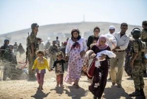 zehntausende-kurdische-syrer-fliehen-ueber-die-grenze-in-die-tuerkei